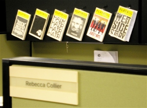 playbills in cubicle